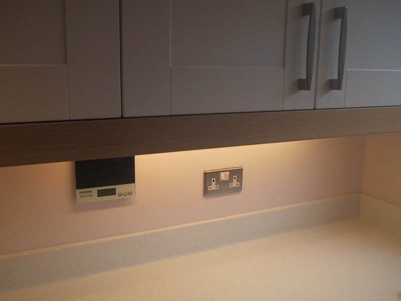 Indoor electrical lighting under cupboard kitchen lighting using miniature fluorescent strip lights aloadofball