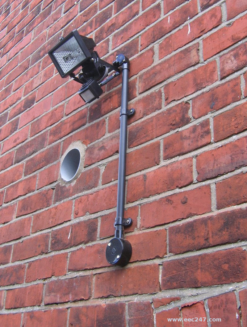 Floodlight in passageway between house and garage